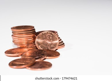 stacks of pennies on a white background