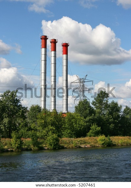 Stacks and powerlines behind the river