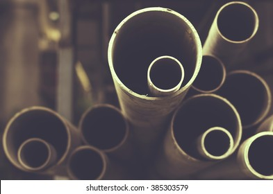 Stacks of PVC water pipes. Abstract circular water pipe.  Selective focus.Toned image.