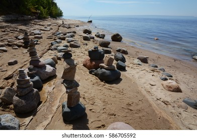 Stacks of rocks, or cairns, line Mosquito Beach along the Pictured Rocks National Lakeshore in the Upper Peninsula of Michigan.