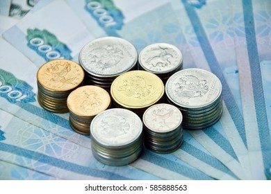 stacks of russian coins on the banknotes background