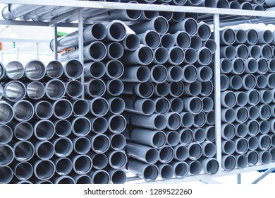 stacks of sewer pipes in warehouse