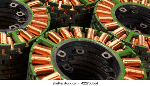 Stacks of stators from old disassembled brushless electric motors.