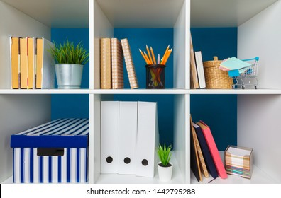 Stacks of supplies and paperwork in the office and bookshelves