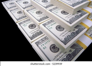 Stacks of Ten Thousand Dollar Piles of One Hundred Dollar Bills on a black background.