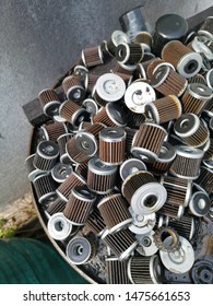 stacks of thrown away car oil filter cyclinderal outdoor,