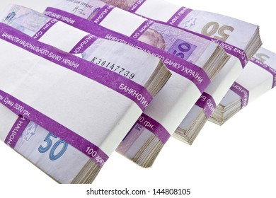 Stacks of ukrainian money closeup isolated on white