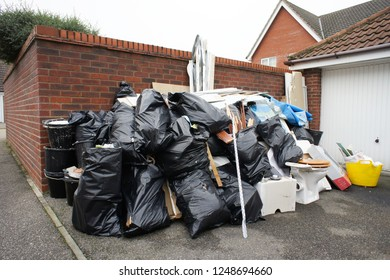 Stacks of waste bags outside a home in the UK