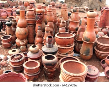 Stacks of West African pottery for sale