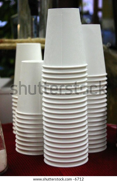 stacks of white disposable paper cups