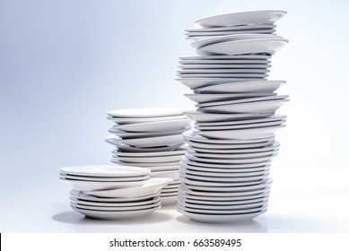 Stacks of white plates isolated on white.