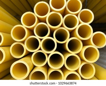 Stacks of yellow PVC(Polyvinyl chloride) pipes  for wire safety, top view