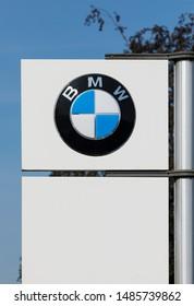 Stade, Germany - August 22, 2019: Logo on pole identifying a BMW dealership.