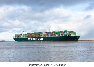 Stade, Germany - January 12, 2021: Container ship EVER GOVERN on Elbe river heading to Hamburg. The vessel is operated by EVERGREEN Marine and sails under Panamese flag.