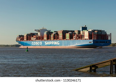Stade, Germany - July 8, 2018: Ultra-large container ship COSCO Shipping Virgo on Elbe river. The vessel is 400m long and holds up to 20,000 TEU. It was delivered in May, 2018.