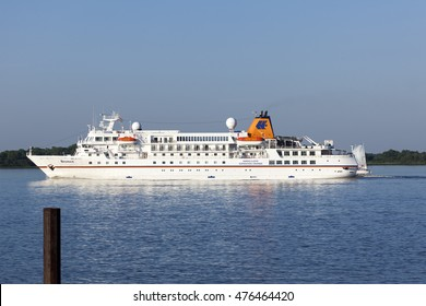 Stade, Germany - June 5, 2015: Cruise ship MS BREMEN, operated by Hapag-Lloyd Expedition Cruises, leaving Hamburg on the Elbe river.