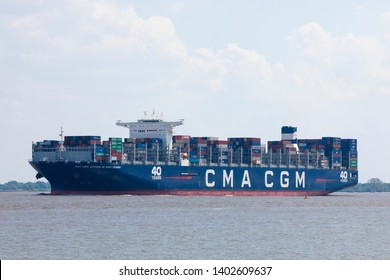 Stade, Germany - May 18, 2019: Container vessel CMA CGM Antoine de Saint Exupery on Elbe river near Hamburg. The flagship of French CMA CGM's fleet is the largest Europe-based ship.