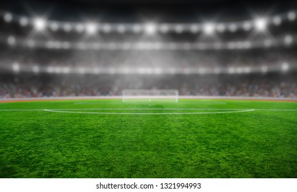 Stadium with the bright lights and green grass