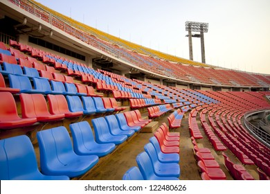 stadium curve, red and blue seat on stadium steps bleacher
