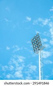 stadium floodlight with blue sky and cloud