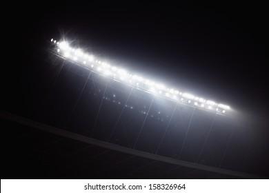 Stadium floodlights at night time
