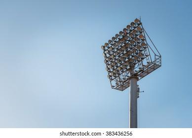 Stadium light against blue sky.