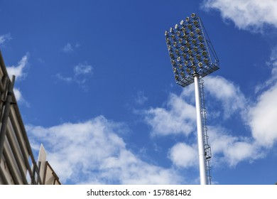 Stadium of light and cloudy blue sky background.