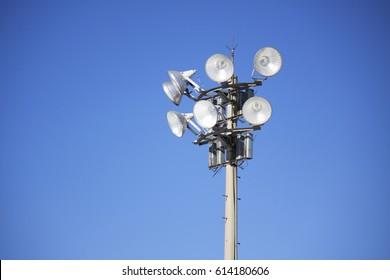 Stadium light pole on blue sky
