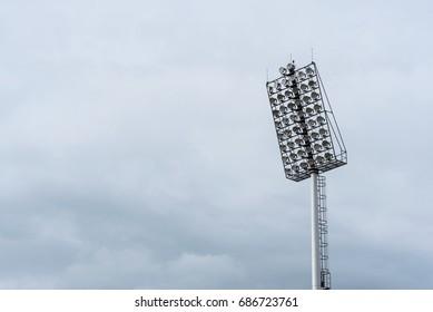Stadium lights with blue sky