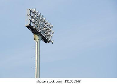 Stadium Lights on Blue Sky Background