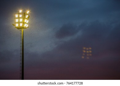 Stadium Lights on a stormy evening. Flood lights on a cloudy afternoon. Lighting the way