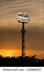 Stadium lights on sunset background