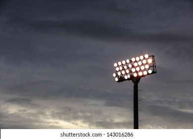 Stadium lights turn on at twilight time