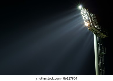 Stadium lights turned on and some insects at night