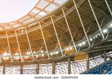 stadium roof with a cloudy blue sky