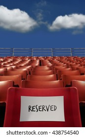 Stadium Seat with Blue Sky Background and Reserved Word on Paper