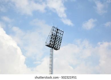stadium spotlight with blue sky background