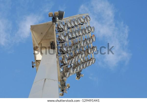 Stadium spot-light tower against blue sky