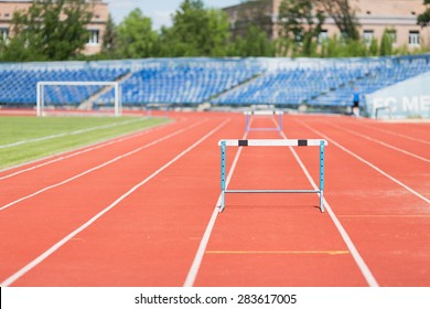 Stadium treadmill.Photo treadmill with a barrier in an empty stadium during the day