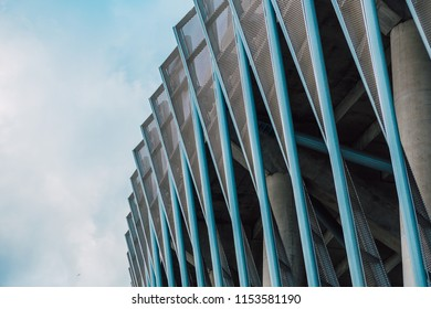 Stadium wall, metal construction, modern architecture on blue sky background