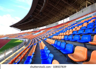 Stadiums amphitheater empty plastic seats in the stadium. Many empty seats for spectators in the stands for football fans and other outdoor sports.A place public government creates to the public.