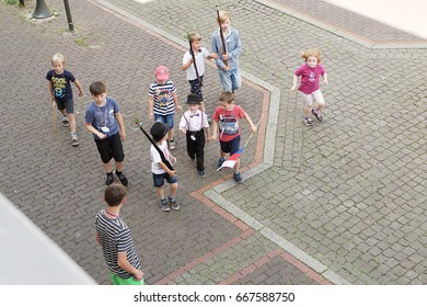 Stadthagen, Germany, June 2017: Kids with wooden toy rifles march through the city, celebrating the marksmen's festival