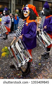 Staenzlergasse, Basel, Switzerland - March 11th, 2019. Close-up of a snare drummer in purple orange carnival costume