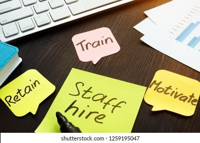 Staff hire, train, motivate and retain written on a memo sticks.