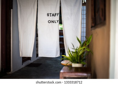 Staff only sign, at the door made from white fabric to keeping c