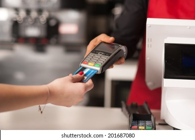 Staff receiving payment by credit card in restaurant