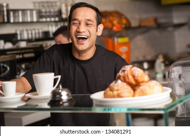 A staff at restaurant bursts out with laughter for a joke cracked by customer.