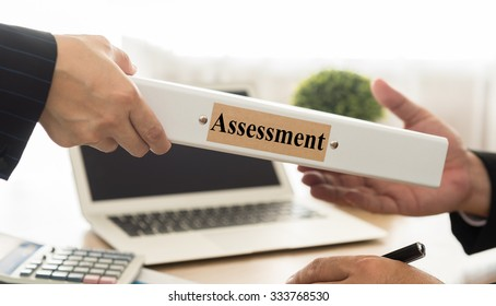 Staff send assessments summary report to the manager. selective focus.