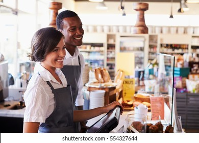 Staff Serving Customers At Delicatessen Checkout