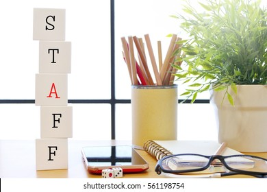 staff - text on a cubic block on the workplace